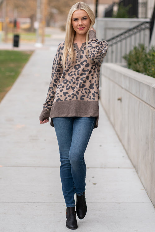 "Hem & Thread   This cozy long sleeve thermal Henley top is perfect paired with denim and short booties. Wear this all winter long to keep warm and trendy.  Collection: Fall 2020 Color: Camel Neckline: Button Down Henley  Sleeve: Long Sleeve SELF:78% POLYESTER 18%RAYON 4% SPANDEX CONTRAST:60% COTTON 35% RAYON Style #: 30049-CAM Contact us for any additional measurements or sizing.  Melissa is 5'5"" and wears a 0 in jeans, small top and size 6 shoe. She is wearing a size small in this top."