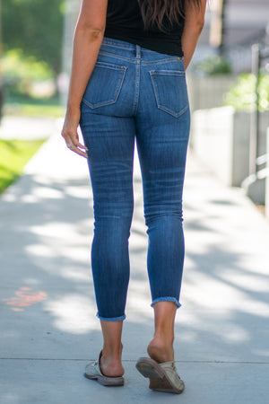 "Kan Can Jeans Collection: Summer 2020 Color: Medium Wash Cut: Frayed Hem Ankle Skinny, 26"" Inseam  Rise: High Rise, 9.5"" Front Rise COTTON 67.5% POLYESTER 25% RAYON 6.5% SPANDEX 1% Fly: Exposed Button Fly Style #: KC7120M"