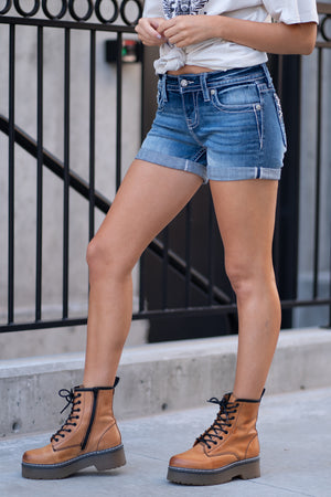 "Miss Me Jeans  Collection: Spring 2020 Color: Medium Dark Wash Cut: Shorts, 3"" Inseam Rise: Mid Rise, 8.75"" Front Rise 98% COTTON / 2% SPANDEX Stitching: Classic Fly: Zipper Style #: M3566H"