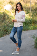 "Hem & Thread   This long sleeve thermal top will keep you warm paired with your favorite denim and warm boots.  Collection: Fall 2020 Color: Mauve Neckline: V-Beck  Sleeve: Long Sleeve 74% RAYON 22% POLYESTER 4% SPANDEX Style #: 8314W Contact us for any additional measurements or sizing.  Chloe is 5'8"" and 130 pounds. She wears a size 26 in jeans, a small top and 8.5 in shoes. She is wearing a size small in this top."