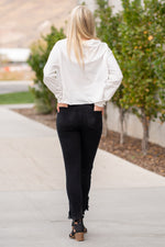 "Zutter  Collection: Fall 2020 Color: White Neckline: Round Sleeve: Long Sleeve Unfinished Hem Crop Sweater Tee Material: COTTON 100% Style #: F2001-0014 Contact us for any additional measurements or sizing.  Melissa is 5'5"" and wears a 2 in jeans, small top and size 6 shoe. She is wearing a size small in this top."