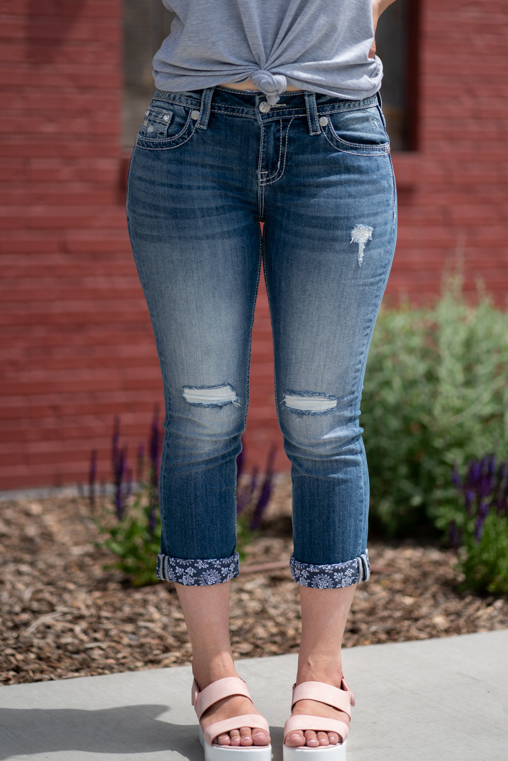 "Miss Me Jeans Collection: Spring 2020 Name: Blue Paisley Capris Color: Medium Dark Wash Cut: Shorts, 23.5"" Inseam Rise: Mid Rise, 8.75"" Front Rise 98% COTTON / 2% SPANDEX Stitching: Classic Fly: Zipper Style #:  M3581P"