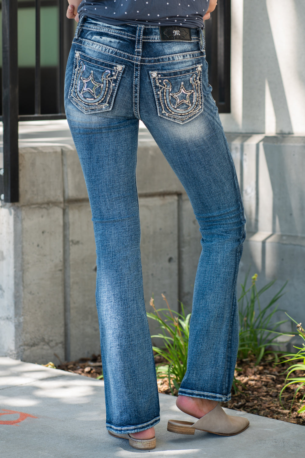 "Miss Me Collection: Summer 2020 Style Name: Embellished Star Horseshoe Color: Dark Wash 73% Cotton, 24% Polyester, 3% Elastane Cut: Boot Cut, 34"" Inseam Rise: Mid-Rise, 8.75"" Front Rise Style #: M3596B Contact us for any additional measurements or sizing."
