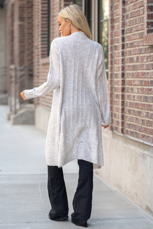 "Hem & Thread   This cozy open cardi sweater can be paired with denim or dressed and will keep you warm and cute.   Collection: Fall 2020 Color: Heather Grey Neckline: Open Sleeve: Long Sleeve 74% ACRYLIC 22% POLYESTER 4% LYCRA  Style #: 30108W Contact us for any additional measurements or sizing.  Haley is 5'6"" and wears size 25 in jeans, a small top and 7.5 in shoes. She is wearing a size small in this sweater.."