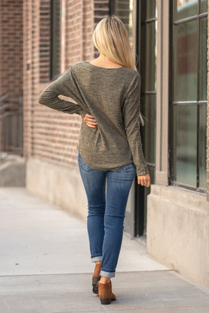 "Hem & Thread   This cozy button sleeve top will keep you warm paired with your favorite denim and warm boots.  Collection: Fall 2020 Color: Forest Green Neckline: Round  Sleeve: Long Sleeve 70% RAYON 25% POLYESTER 5% SPANDEX Style #: 8232F Contact us for any additional measurements or sizing.  Haley is 5'6"" and wears size 3 in jeans, a small top and 7.5 in shoes. She is wearing a size small in this top."