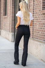 "Miss Me Collection: Spring 2020 Color: Black 74% Cotton 24% Polyester 3% Spandex Cut: Trouser Flare Cut, 34"" Inseam Rise: High Rise, 10"" Front Rise Style #: H1039F2  Contact us for any additional measurements or sizing.  Haley is 5'6"" and wears size 3 in jeans, a small top and 7.5 in shoes. She is wearing a 25 in these jeans."