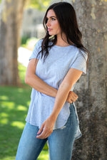 The top is a must-have to wear with every high waist denim. If you like to wear high waist jeans but hate crop tops, this is the perfect tee for you. Pair it with your favorite accessories to dress it up, or keep it casual by itself.   Collection: Core Style Style Name: Split Hem Tee Color: Grey Cut: Short Sleeve, Split Hem, Round Neck Material: 51%Cotton 49%Modal Style #: AM69411 Contact us for any additional measurements or sizing.