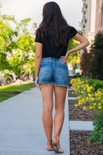 "High Rise Boyfriend Shorts By Kan Can  Collection: Summer 2020 Boyfriend Shorts High Rise waist, 11"" Front Rise Shorts, 3"" Inseam Dark Wash Material: 100% COTTON  Stitching: Classic Fly: Exposed Button Fly Style #: KC7823D"