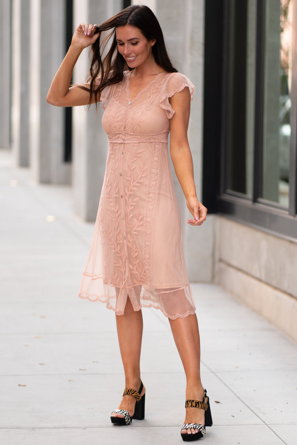 Miss Me  Collection: Fall 2020 Lace Two Piece Dress Color: Blush Pink Cut: Midi Button Down Self: 80% Cotton, 20% Polyester; Lining: 100% Polyester Style #: MD0294S-BLUSH Dream in style with this sweet dress featuring an all over sheer lace fabric, button down closures at front, inside slip, short flutter sleeves, a v-neck line and a midi cut.  Contact us for any additional measurements or sizing.