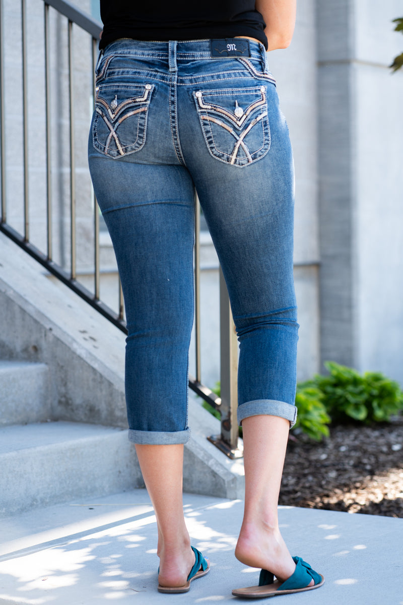 "Miss Me Jeans  Collection: Spring 2020 Name: Criss Cross Capris Color: Medium Dark Wash Cut: Shorts, 23.5"" Inseam Rise: Mid Rise, 8.75"" Front Rise 93% COTTON 6% Polyester 2% SPANDEX Stitching: Classic Fly: Zipper Style #: M3444P11"