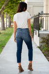 "KanCan Jeans Collection: Fall 2020 Color: Dark Wash  Ankle Skinny, 27"" Inseam  High Rise, 10"" Front Rise Distressed Relaxed Mom Fit COTTON 99% SPANDEX 1% Fly: Zipper Style #: KC7133D Contact us for any additional measurements or sizing.  Chloe is 5'8"" and 130 pounds. She wears a size 3 in jeans, a small top and 8.5 in shoes. She is wearing a 26/3 in these jeans."