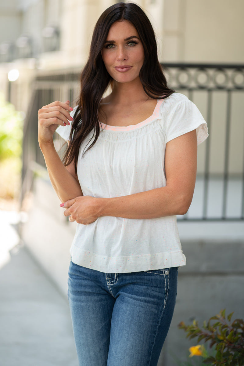 Miss Me  Collection: Fall 2020 Rodeo Easy Style Color: White Cut: Flutter Sleeve  95% Cotton, 5% Polyester Style #: MJT0062T Show off your easy going style with this must have top featuring short frill sleeves, and a square neck line.   Contact us for any additional measurements or sizing.  Chloe is 5'8