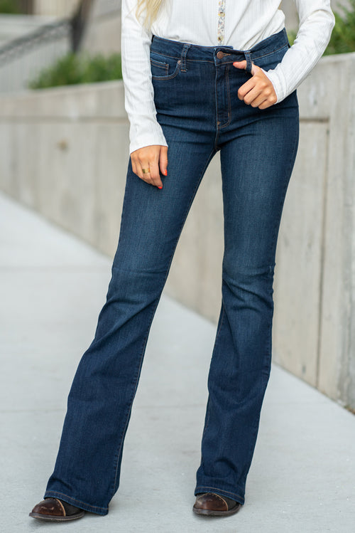 "Just USA Jeans  Color: Dark Wash Flare cut, 32"" Inseam Rise: High Rise, 10"" Front Rise 51% Cotton, 26% Rayon, 12% Polyester, 1% Lycra Machine Wash Separately In Cold Water Stitching: Classic Fly: Zipper Style #: JP085 Contact us for any additional measurements or sizing.  Haley is 5'6"" and wears size 25 in jeans, a small top and 7.5 in shoes. She is wearing a 25 in these jeans."