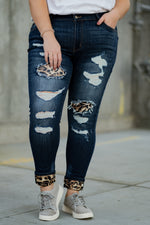 "Kan Can Jeans  Collection: Core Style Name: Leopard Patch Skinny Color: Medium Dark Wash Cut: Skinny, 29.5"" Inseam Rise: Mid-Rise, 10"" Front Rise 80.4% COTTON 11% POLYESTER 6.6% MODAL 2% SPANDEX Fly: Zipper  Style #: KC8191LD-PL  Contact us for any additional measurements or sizing.  Victoria's wears a 16W and is wearing a size 2XL in these jeans."