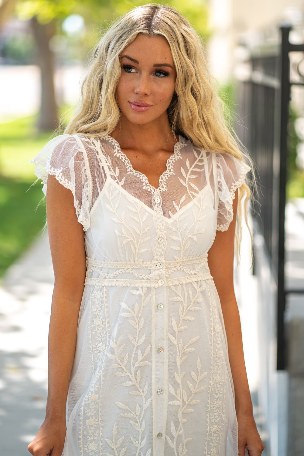 Miss Me  Collection: Summer 2020 Lace Two Piece Dress Color: Ivory White Button Down Self: 80% Cotton, 20% Polyester; Lining: 100% Polyester Style #: MD0294S Dream in style with this sweet dress featuring an all over sheer lace fabric, button down closures at front, inside slip, short flutter sleeves, a v-neck line and a midi cut.  Contact us for any additional measurements or sizing.