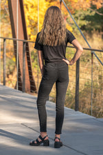 "Nature Denim  Collection: Fall 2020 Color: Black Washed Cut: Skinny, 27"" Inseam Rise: Mid Rise, 9"" Front Rise  81% cotton 15% polyester 2% rayon 2% spandex Fly: Zipper Style #: NT1215BK Contact us for any additional measurements or sizing."