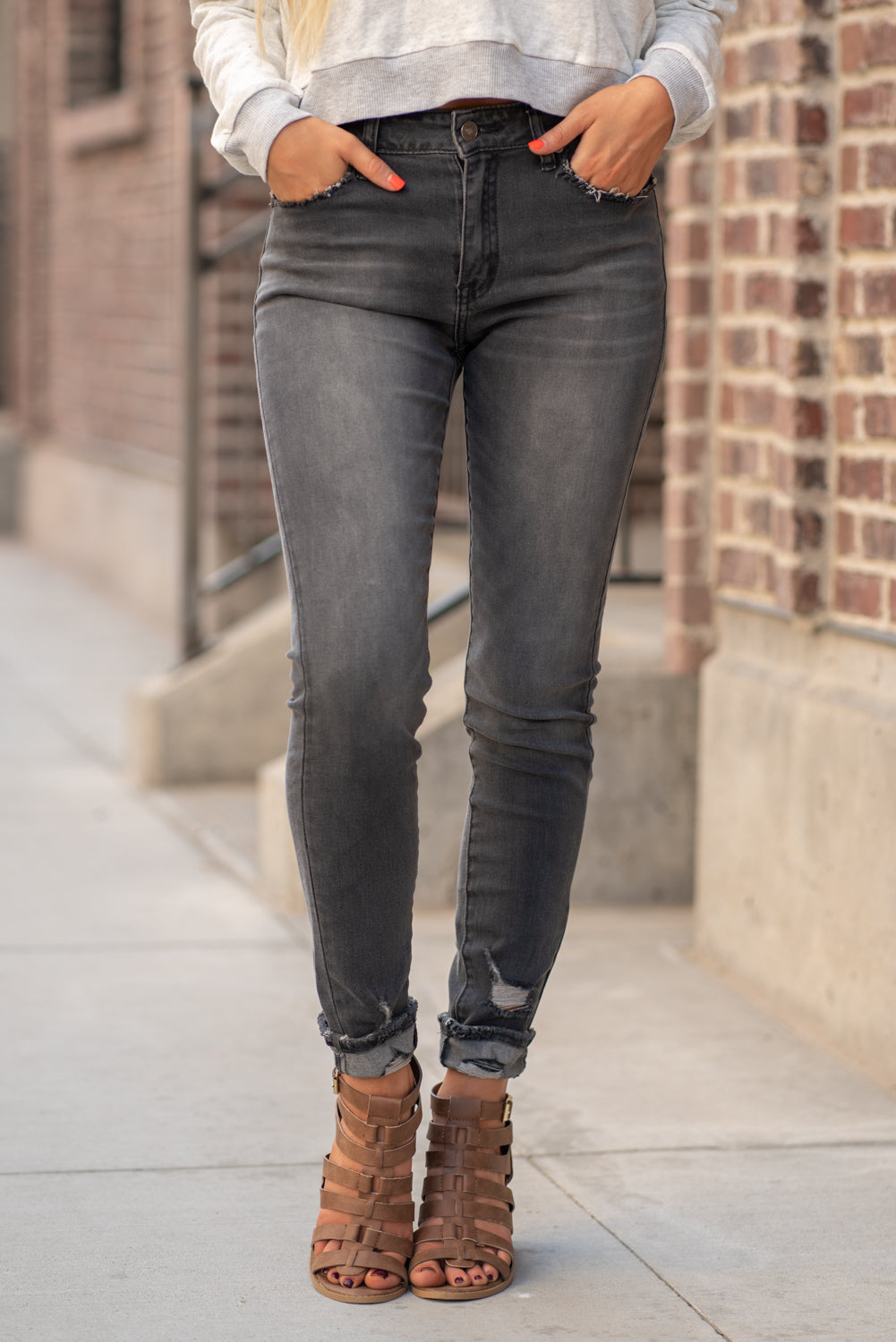 "KanCan Jeans Collection: Fall 2020 Color: Dark Grey Skinny, 29"" Inseam  Mid Rise, 9"" Front Rise Ripped Distressed Ankles COTTON 84.9% POLYESTER 14% SPANDEX 1.1% Fly: Zipper Style #: KC7266GD  Contact us for any additional measurements or sizing.  Haley is 5'6"" and wears size 25 in jeans, a small top and 7.5 in shoes. She is wearing a 25 in these jeans."