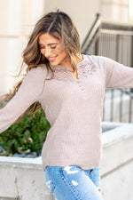 "Hem & Thread   This cozy stone long sleeve thermal Henley top is perfect to layer with cozy sweaters and paired with denim.   Collection: Fall 2020 Color: Stone Neckline: Round  Sleeve: Long Sleeve 95% POLYESTER 5% SPANDEX Style #: 8469J Contact us for any additional measurements or sizing.  Taylor is 5'7"" and wears a size 4 in jeans, small top and an 8.5 in shoes. She is wearing a size small in this top."