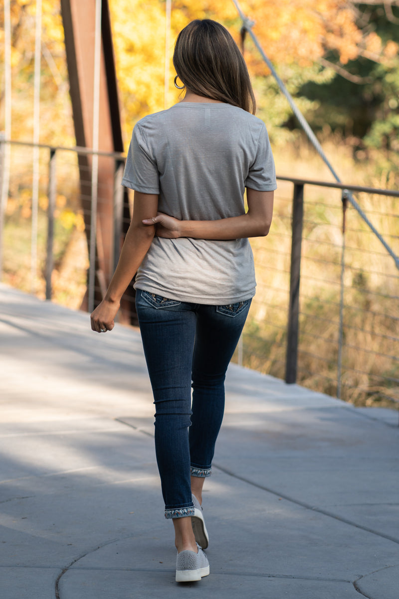 "Show your love for fall with this cute its Fall Yall Tee  Collection: Fall 2020 Color: Stone Neckline: V Neck Sleeve: Short 91% Polyester 9% Cotton Contact us for any additional measurements or sizing.  Taylor is 5'7"" and wears a size 3 in jeans, small top and an 8.5 in shoes. She is wearing a size small in this tee."