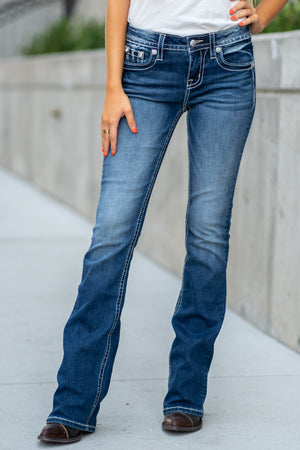 "Miss Me Collection: Fall 2020 Wash: Dark Blue Inseam: 34"" Boot Cut 93% Cotton, 5% Polyester, 2% Elastane Mid Rise, 8.75"" Front Rise Embellished Silver Embellished Pocket Style #: M3638B Contact us for any additional measurements or sizing.  Haley is 5'6"" and wears size 3 in jeans, a small top and 7.5 in shoes. She is wearing a 25 in these jeans."