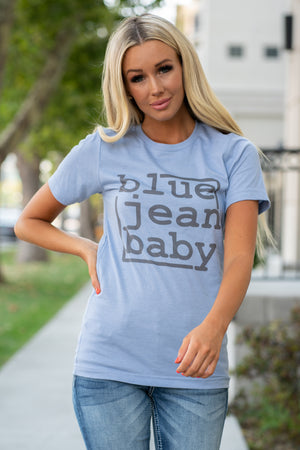 "This top is our mood and says it all. Be our blue jean baby.  Collection: Fall 2020 Color: Heather Blue Neckline: Round Sleeve: Short 52% Cotton 48% POLYESTER Contact us for any additional measurements or sizing.  Haley is 5'6"" and wears size 3 in jeans, a small top and 7.5 in shoes. She is wearing a size x-small in this top for a fitted look."
