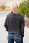 "Zutter  Collection: Fall 2020 Color: Black Neckline: Round Sleeve: Long Sleeve Unfinished Hem Crop Sweater Tee Material: COTTON 100% Style #: F2001-7691 Contact us for any additional measurements or sizing.  Melissa is 5'5"" and wears a 2 in jeans, small top and size 6 shoe. She is wearing a size small in this top."