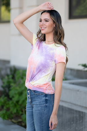 "Hem & Thread   Living in the 90s? This top will be your new favorite. Pair with a great boyfriend denim in heels for a trendy fun look.  Collection: Fall 2020 Color: Tie Dye Pink Neckline: Round Sleeve: Short 75% RAYON 25% SPANDEX Style #: 7945 Contact us for any additional measurements or sizing.  Haley is 5'6"" and wears size 3 in jeans, a small top and 7.5 in shoes. She is wearing a size small in this top."