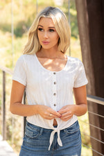 Hem & Thread   Light and easy, this knot top is great for layering.  Collection: Fall 2020 Color: Ivory White Neckline: Round Sleeve: Short Sleeve 65% POLYESTER 35% COTTON Style #: 7841G Contact us for any additional measurements or sizing.  Haley wears a size small top, a 3 in jeans and a small in tops. She is wearing a size small in this top.
