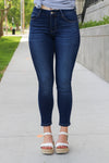 "Vervet Flying Monkey Jeans  Collection: Spring 2020 Style Name: Blue Bridges Super Soft Color: Dark Wash Cut: Ankle Skinny, 28"" Inseam Rise: Mid-Rise, 8.75"" Front Rise Material: 54% Cotton 34% Rayon 10% Polyester 2% Spandex  Machine Wash Separately In Cold Water Stitching: Classic Fly: Zipper Style #: VT643  Contact us for any additional measurements or sizing.  Caden is 5'8"" and wears a size 27 in jeans and a small in top. She is wearing a size 27 in these jeans."