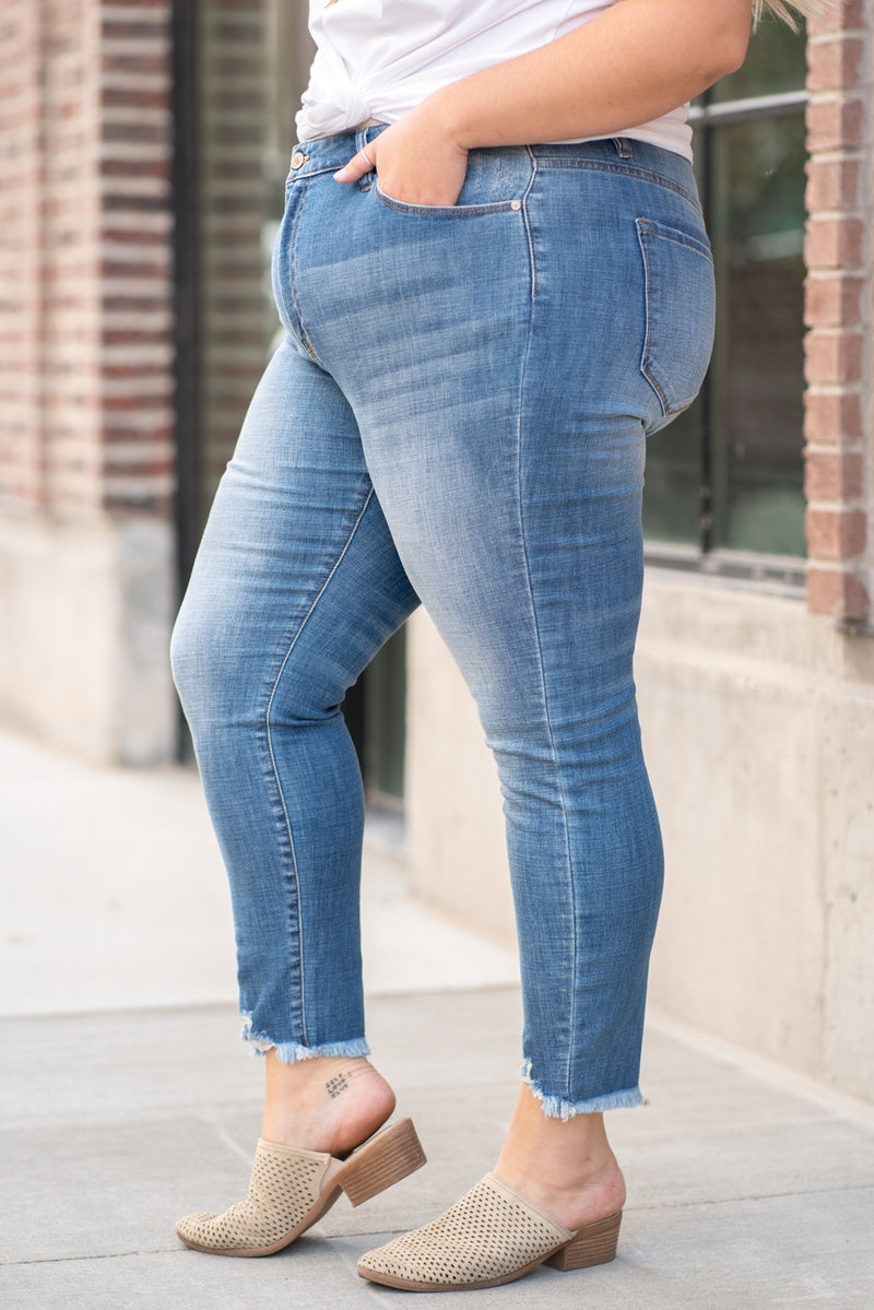 "KanCan Jeans  Collection: Core Style Color: Medium Wash Cut: Ankle Skinny, 27"" Inseam Rise: High-Rise, 9.5"" Front Rise COTTON 91.9% POLYESTER 7% SPANDEX 1.1% Fly: Zipper  Style #: KC7274M Contact us for any additional measurements or sizing.  Victoria is wearing a size 2XL in these jeans."