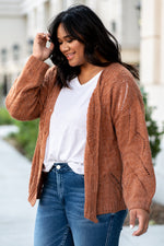 "Miss Me  Collection: Fall 2020 Cozy Up Color: Ginger Brown Neckline: Round Sleeve: Bell Sleeve Style #: MSW0179L Contact us for any additional measurements or size.  Amelia is 5'9"" and wears a 14W and 1XL top."