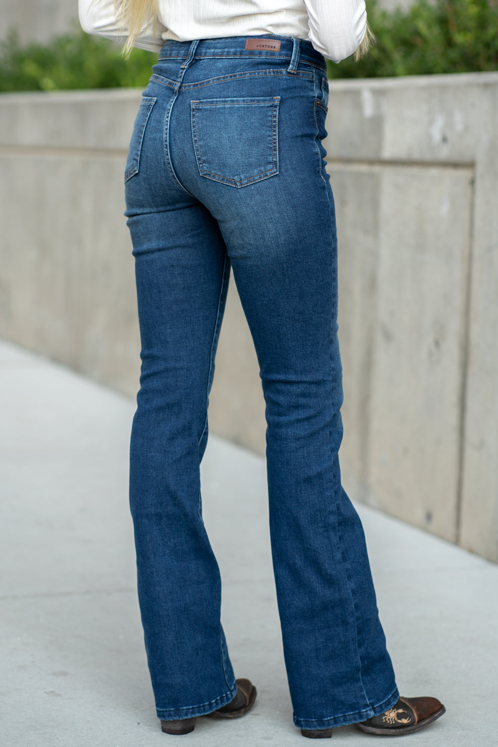 "Just USA Jeans  Color: Medium Dark Wash Boot cut, 32"" Inseam Rise: High Rise, 10"" Front Rise 3% Rayon, 67.8% Rayon 27.1% POLYESTER, 2.1% SPANDEX Machine Wash Separately In Cold Water Stitching: Classic Fly: Zipper Style #: JP100 Contact us for any additional measurements or sizing.  Haley is 5'6"" and wears size 25 in jeans, a small top and 7.5 in shoes. She is wearing a 25 in these jeans."