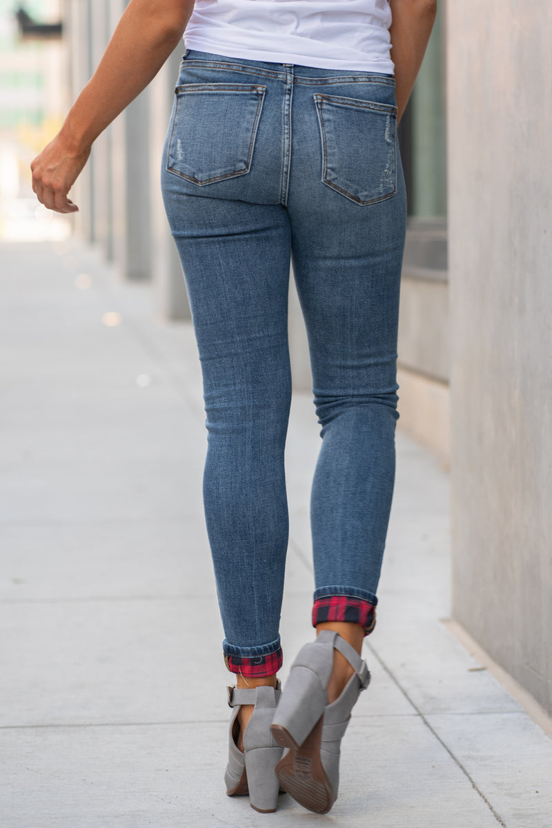 "Judy Blue Collection: Fall 2020 Style Name: Buffalo Red Plaid Patch Color: Medium Wash Cut: Skinny, 29"" Inseam Rise: Mid-Rise, 9"" Front Rise Material: 93% COTTON, 6% POLYESTER, 1% SPANDEX Machine Wash Separately In Cold Water Stitching: Classic Fly: Zipper Style #: JB82167 , 82167  Contact us for any additional measurements or sizing.  Chloe is 5'8"" and 130 pounds. She wears a size 5 in jeans, a small top and 8.5 in shoes. She is wearing a small in these shorts."