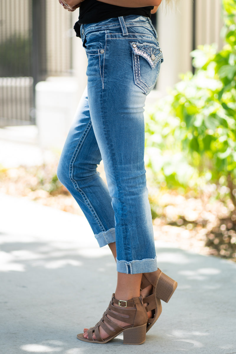 "Miss Me Jeans Collection: Summer 2020 Color: Medium Wash Cut: Capri, 23"" Inseam Rise: Mid Rise, 8.75"" Front Rise 92% Cotton 6% Polyester 2% Elastane Stitching: Classic Fly: Zipper Style #: M3531P Contact us for any additional measurements or sizing."