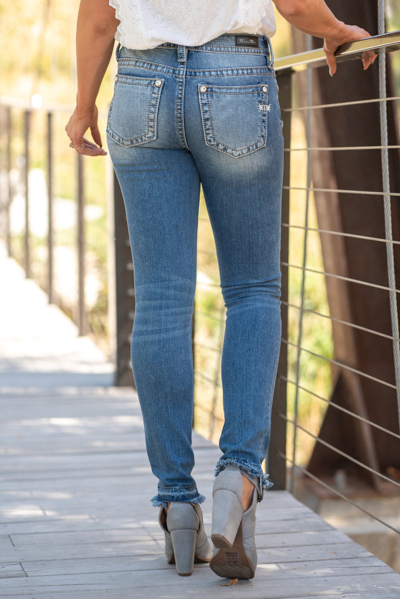 "Miss Me Collection: Fall 2020 Wash: Medium Wash Skinny, 30"" Inseam Mid Rise, 9"" Front Rise  98% Cotton 2% Elastane Sequin Trim and Rhinestone Rivets  Style #: M3636S7 Contact us for any additional measurements or sizing.  Chloe is 5'8"" and 130 pounds. She wears a size 26 in jeans, a small top and 8.5 in shoes. She is wearing a 26/3 in these jeans."