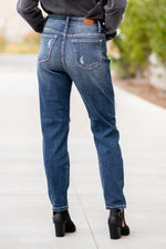 "Judy Blue Collection: Fall 2020 Color: Dark Wash Cut: Boyfriend, 28"" Inseam Rise: High Rise, 10.55"" Front Rise  93% COTTON / 6% POLYESTER / 1% SPANDEX Machine Wash Separately In Cold Water Stitching: Classic Detail: Heavy Distressed Ripped Legs Fly: Zipper Style #: JB82156 , 82156 Contact us for any additional measurements or sizing.  Melissa is 5'5"" and wears a 2 in jeans, small top and size 6 shoe. She is wearing a size 25 in these jeans."