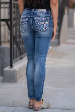 "Miss Me  Collection: Summer 2020 Style Name: Americana Cross Color: Medium Wash 93% Cotton 6% Polyester 2% Elastane Cut: Skinny Cut, 30"" Inseam Rise: Mid-Rise, 8.75"" Front Rise Style #: M3582S"