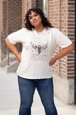 Zutter  Every great dream begins with a dreamer. Flaunt your sass in this cute tee.  Collection: Fall 2020 Color: Light Khaki Neckline: Round Sleeve: Short Material: 100% Cotton Style #: 88525-7476 Contact us for any additional measurements or sizing.  Amelia is a size 14w in jeans, and a 1XL in tops.