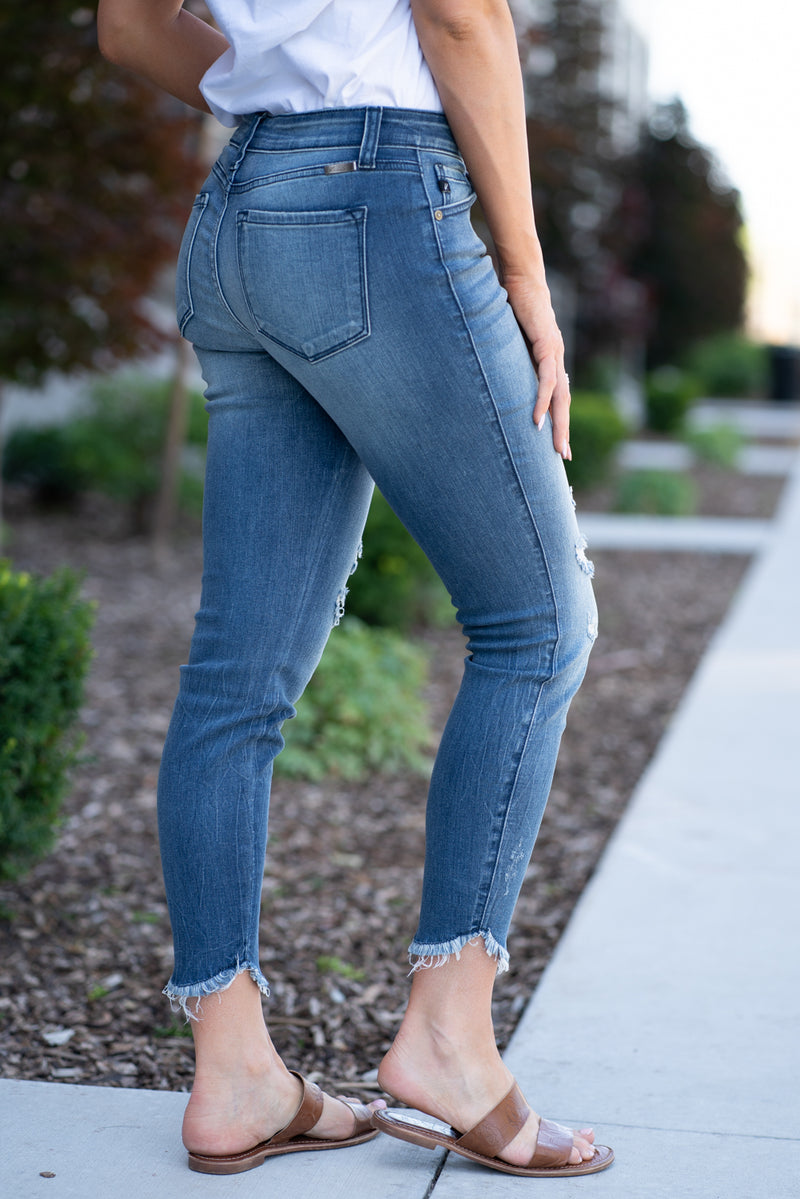 "Kan Can Jeans   Collection: Core Collection Style Name: Isla Color: Medium Wash Cut: Ankle Skinny, 26"" Inseam Rise: Mid Rise, 8.5"" Front Rise Stitching: Classic Fly: Zipper Style #: KC8298M"
