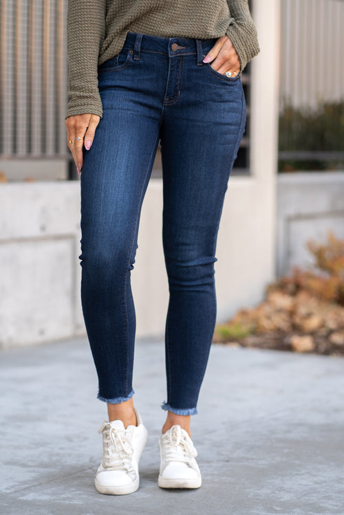 "Just USA Jeans  Color: Dark Blue Cut: Ankle Skinny, 27"" Inseam Mid Rise, 8.5"" Front Rise   Stitching: Classic 50% RAYON, 38.9% COTTON, 9.4% POLYESTER, 1.7% SPANDEX Fly: Zipper Style #: JP059-DK Contact us for any additional measurements or sizing.  Chloe is 5'8"" and 130 pounds. She wears a size 26 in jeans, a small top and 8.5 in shoes. She is wearing a 4 in these jeans."