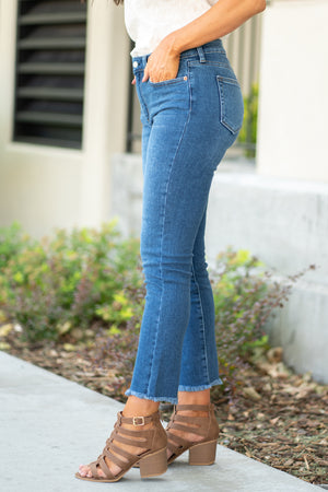"Just USA Jeans  Color: Dark Blue Cut: Crop Mom Skinny, 27"" Inseam Rise: High Rise, 10"" Front Rise 93% Cotton, 5% Polyester, 2% Spandex Machine Wash Separately In Cold Water Stitching: Classic Fly: Zipper Style #: JP092-DK Contact us for any additional measurements or sizing.  Chloe is 5'8"" and 130 pounds. She wears a size 3 in jeans, a small top and 8.5 in shoes. She is wearing a 26/3 in these jeans."
