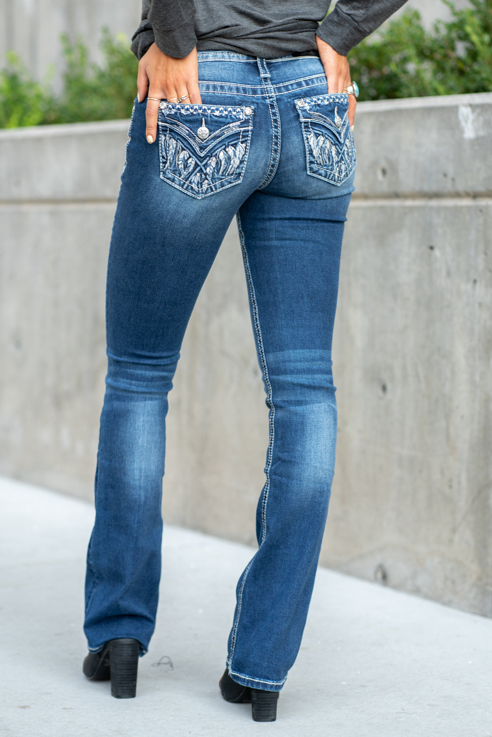 "Miss Me Collection: Fall 2020 Wash: Dark Blue Inseam: 34"" Boot Cut 91% Cotton, 6% Polyester, 3% Elastane Sequin Trim and Rhinestone Rivets Mid Rise, 8.75"" Front Rise Embellished Feather Full Pocket Style #: M3643B Contact us for any additional measurements or sizing.  Taylor is 5'7"" and wears a size 3 in jeans, small top and an 8.5 in shoes. She is wearing a size 25 in these jeans."