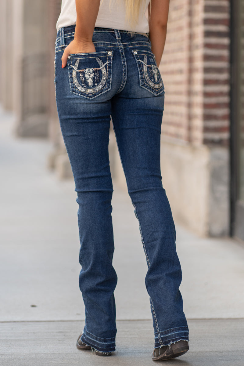 "Miss Me Collection: Fall 2020 Wash: Dark Blue Inseam: 34"" Boot Cut 93% Cotton, 5% Polyester, 2% Elastane Mid Rise, 8.75"" Front Rise Embellished Bull Horn  Style #: M3640SB Contact us for any additional measurements or sizing.  Haley is 5'6"" and wears size 3 in jeans, a small top and 7.5 in shoes. She is wearing a 25 in these jeans."
