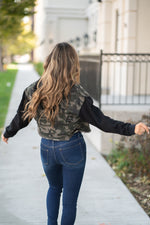 "KanCan Jeans  Collection: Fall 2020 Color: Green Camo, Black Cut: Half Fit Denim Jacket with Frayed Hem Material: 100% Cotton Stitching: Classic Style #: KC5220CM Contact us for any additional measurements or sizing.  Taylor is 5'7"" and wears a size 4 in jeans, small top and an 8.5 in shoes. She is wearing a size small in this jacket."