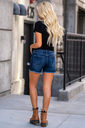 "Just Black Jeans   Color: Medium Wash Cut: Frayed Hem Shorts, 3.5"" Inseam Rise: Mid Rise, 8.5"" Front Rise Material: 98% Cotton 2% Spandex Machine Wash Separately In Cold Water Stitching: Classic Fly: Zip Fly Style #: BH140J"