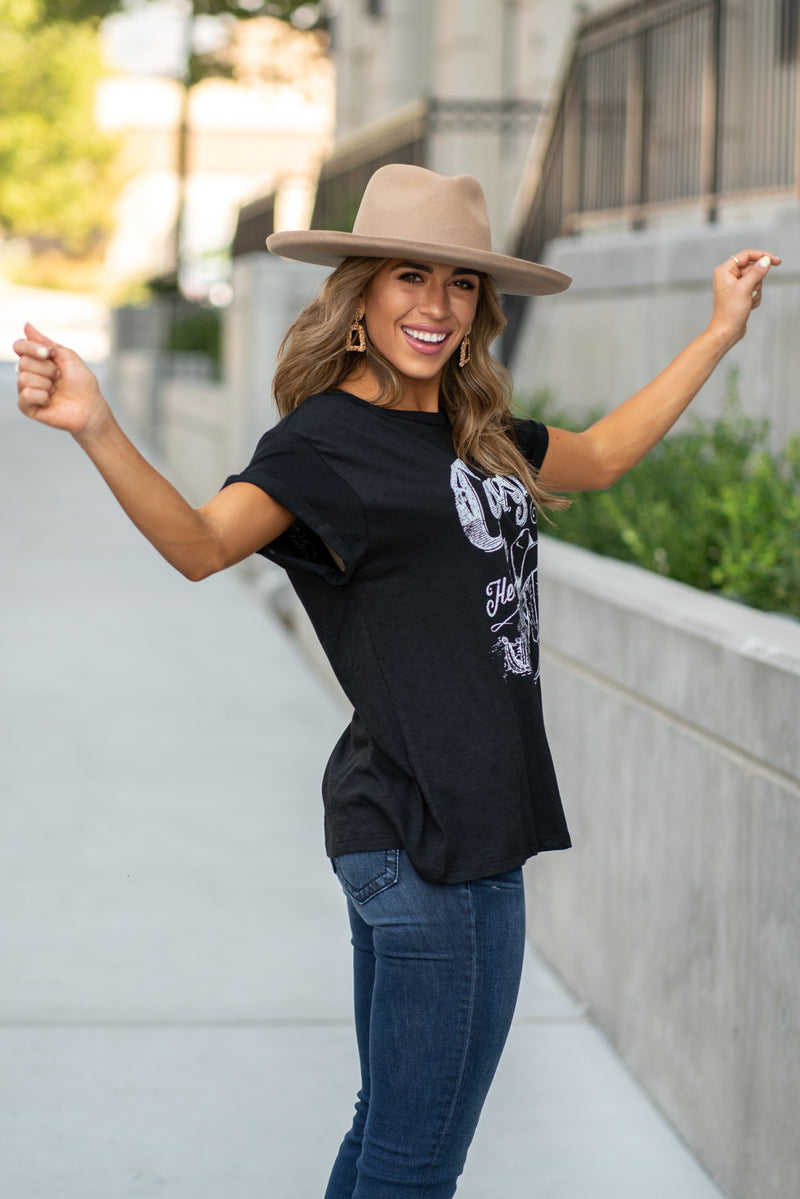 "Zutter  This top spoke to you, now tell everyone else. You are a cowgirl at heart.  Collection: Fall 2020 Color: Black Neckline: Round Sleeve: Short Material: 50% Modal 50% Cotton Style #: F425-0139 Contact us for any additional measurements or sizing.  Taylor is 5'7"" and wears a size 3 in jeans, small top and an 8.5 in shoes. She is wearing a size small in this tee."