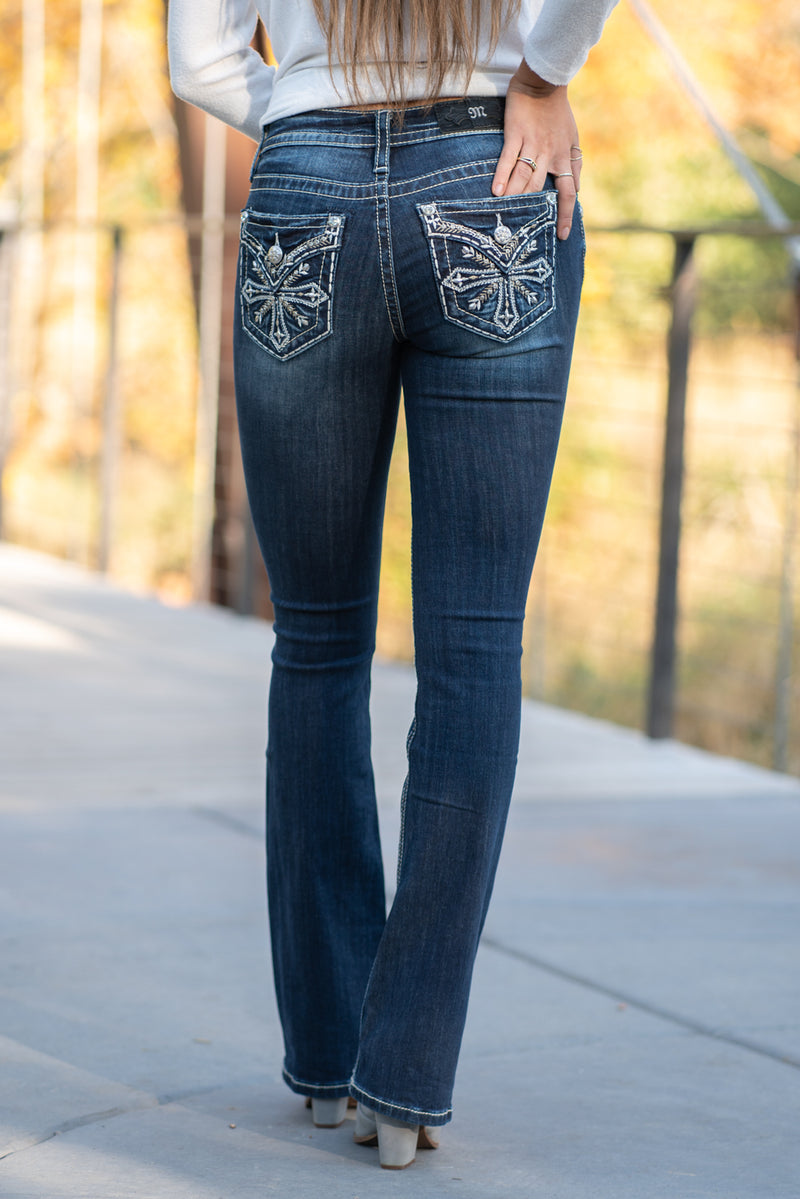 "Miss Me Collection: Fall 2020 Wash: Dark Wash Inseam: 34"" Boot Cut Sequin Trim and Rhinestone Rivets  Mid Rise, 8.75"" Front Rise Embellished Silver Cross Style #: M3690B Contact us for any additional measurements or sizing.  Taylor is 5'7"" and wears a size 4 in jeans, small top and an 8.5 in shoes. She is wearing a size 26 in these jeans."