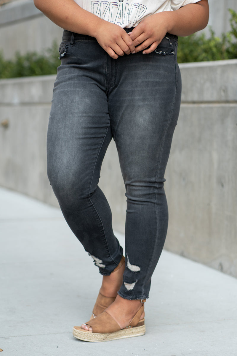 "KanCan Jeans Collection: Fall 2020 Color: Dark Grey Skinny, 30"" Inseam  Mid Rise, 11"" Front Rise Ripped Distressed Ankles COTTON 84.9% POLYESTER 14% SPANDEX 1.1% Fly: Zipper Style #: KC7266GD-PL  Contact us for any additional measurements or sizing.  Amelia wears a 14W and 1XL top. She is wearing a 1X in these jeans."