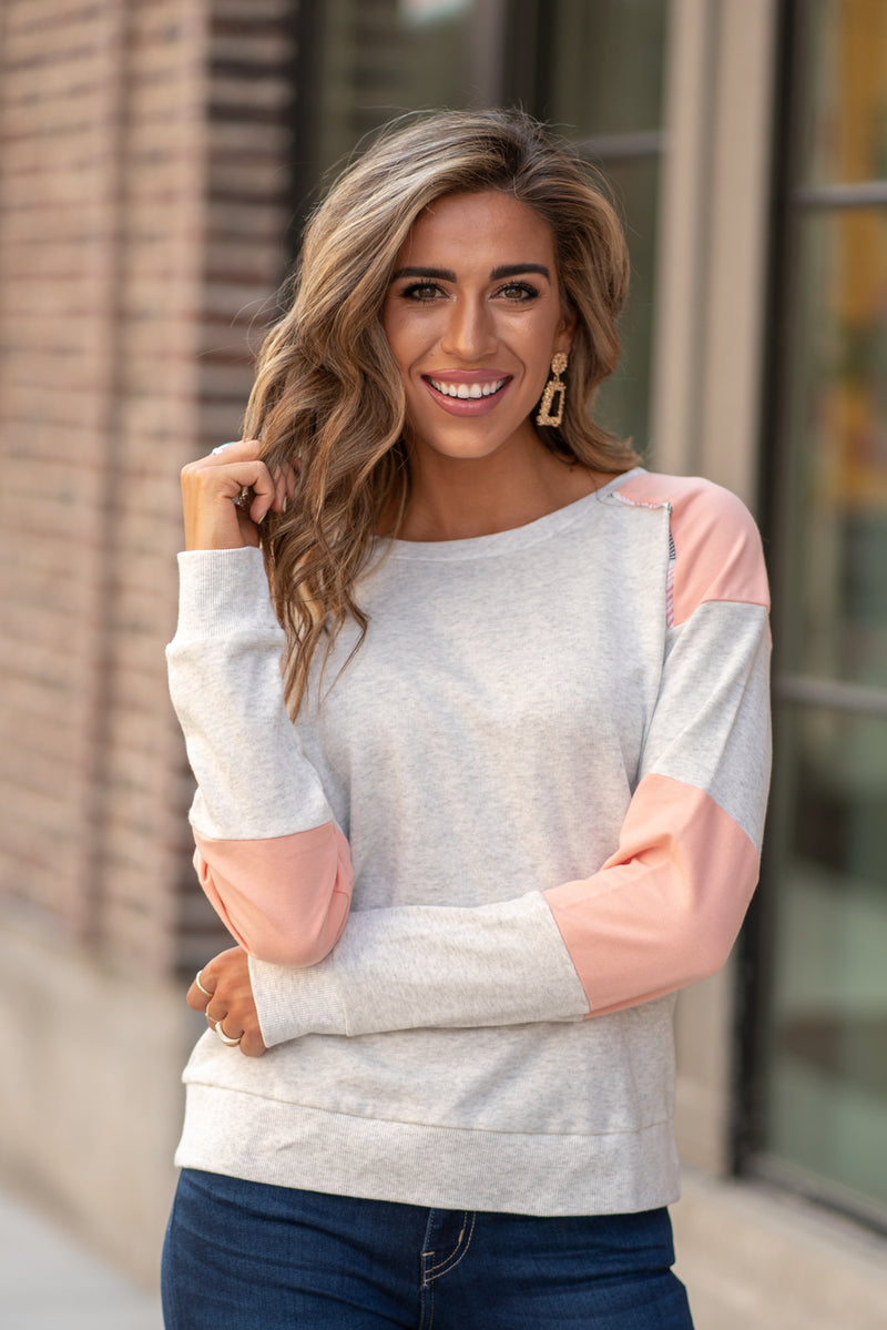 Hem & Thread   This cozy color block sweater will keep you warm paired with your favorite denim and warm boots.  Collection: Fall 2020 Color: Pink & Heather Grey Neckline: Crew Round  Sleeve: Long Sleeve SELF 100% COTTON CONTRAST : 65% COTTON 35% POLYESTER Style #: 7732F  Contact us for any additional measurements or sizing.  Taylor is 5'7