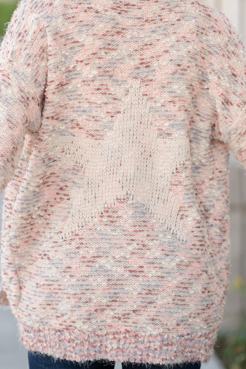 "Hem & Thread   This cozy open cardi sweater can be paired with denim or dress and will keep you warm and cute while showing your patriotism.   Collection: Fall 2020 Color: Blush Pink Neckline: Open Long Sleeve Cardi 60% ACRYLIC 40% POLYESTER Style #: 8231F Contact us for any additional measurements or sizing.  Taylor is 5'7"" and wears a size 3 in jeans, small top and an 8.5 in shoes. She is wearing a size small in this sweater."
